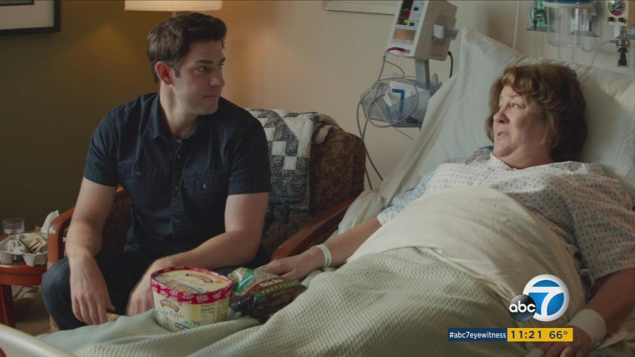 John Krasinski is shown alongside actress Margo Martindale in a scene from their new movie The Hollars.