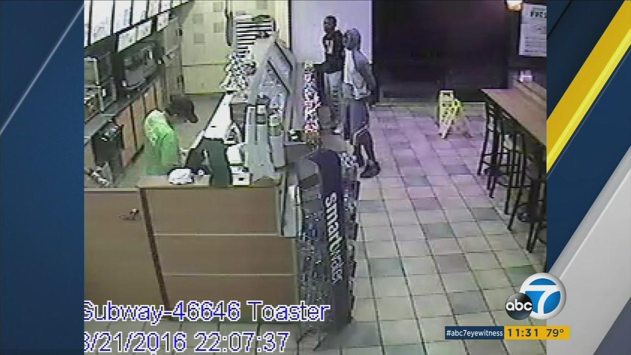Torrance police are looking for two men who ripped cash registers out of two Subway shops in Torrance and possibly were looking to hit another before they narrowly escaped.