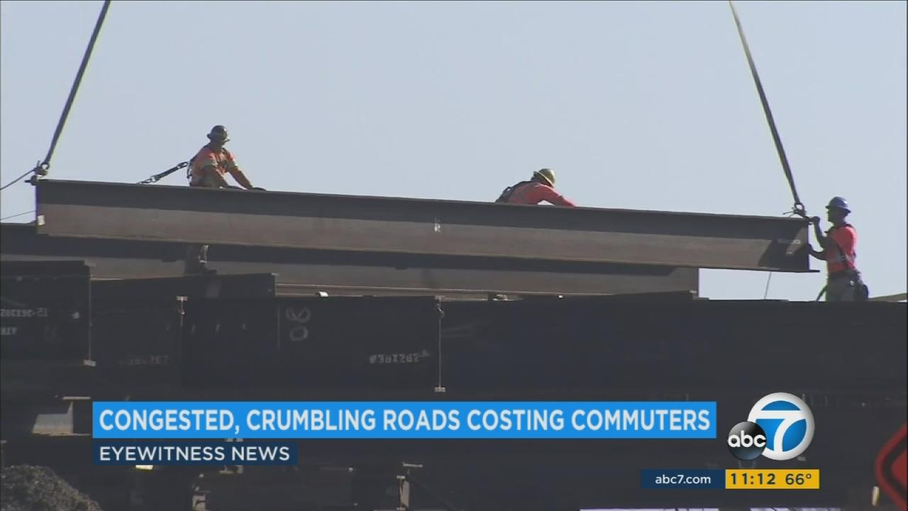 Crews worked to put together a bridge or piece of highway in an undated file photo.