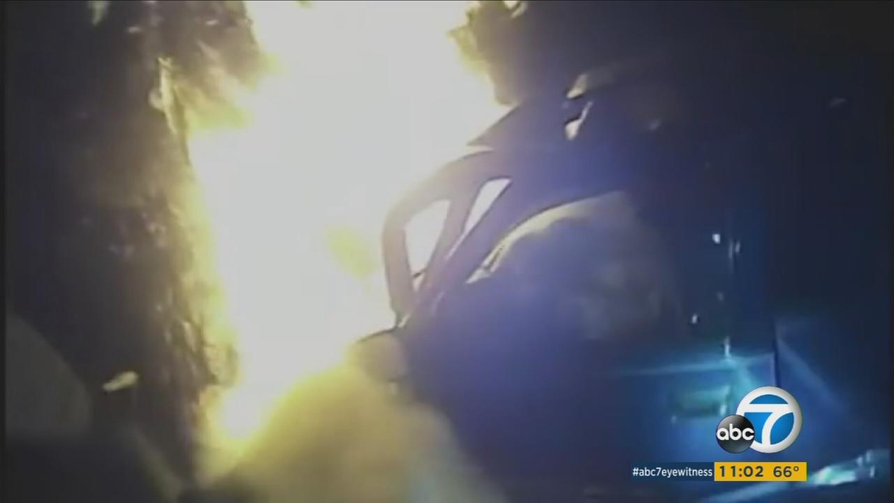 Bodycam footage shows a Georgia police officer rescuing a passenger caught in a fiery SUV wreck.