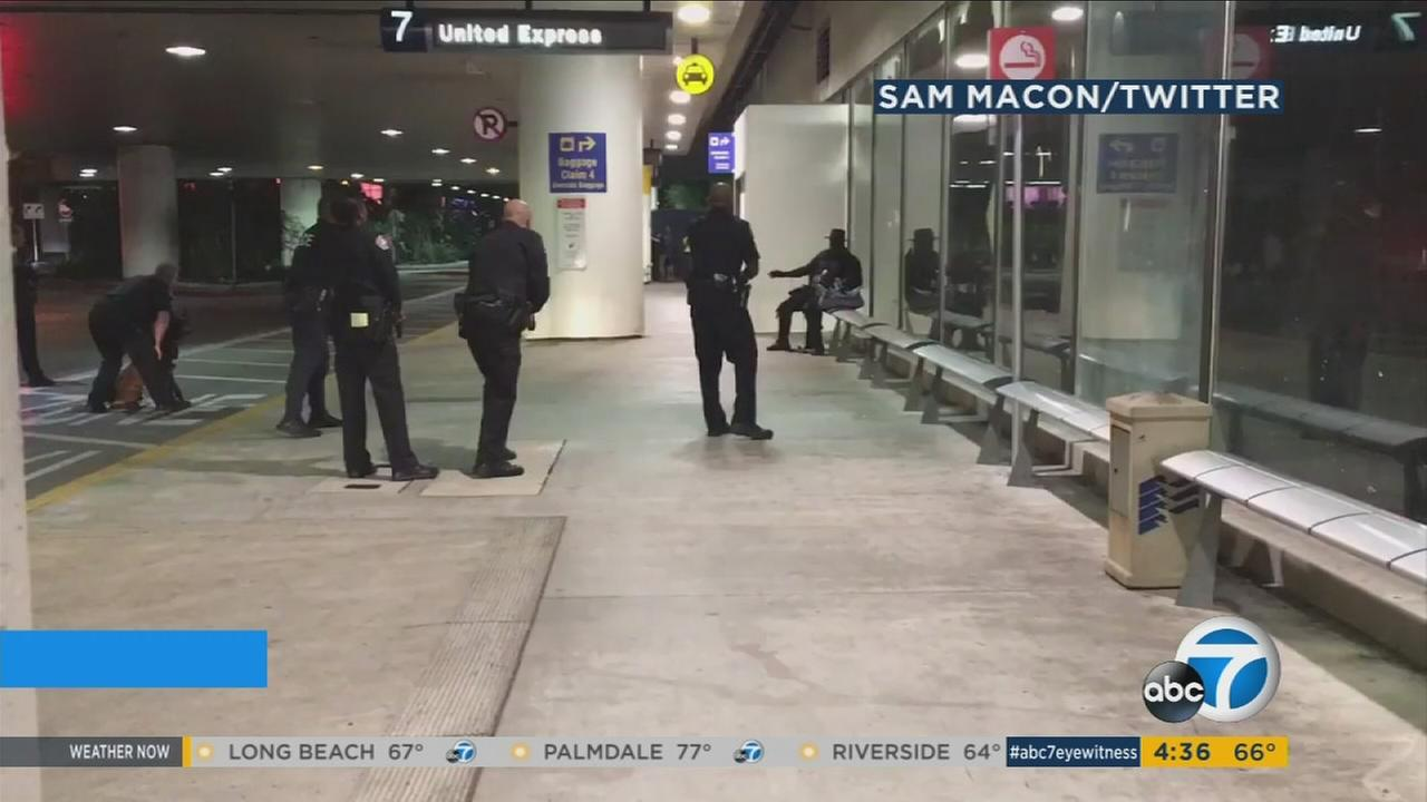 A man dressed as Zorro was detained during a false report of shots fired at Los Angeles International Airport on Sunday, Aug. 29, 2016.