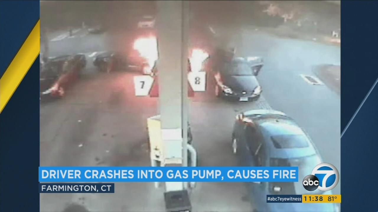 A driver backed into a gas pump in Farmington, Conn., sparking a fire that destroyed two cars and damaged three others.