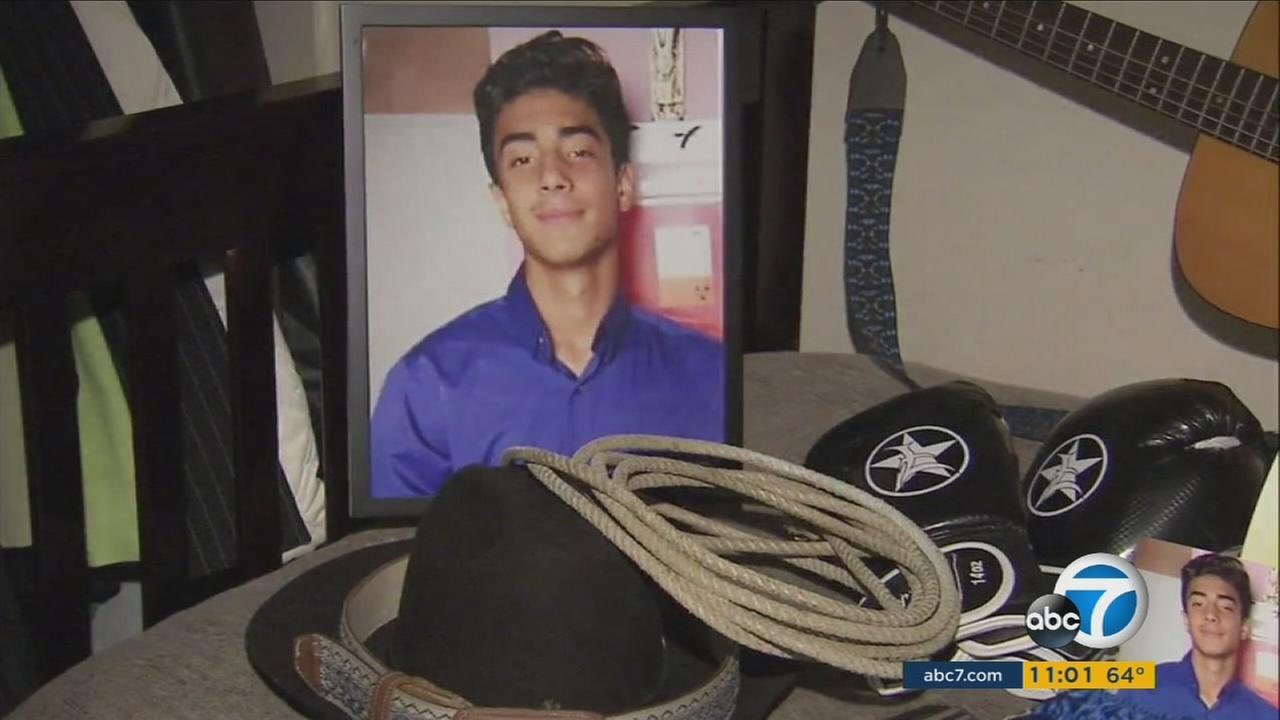 Luis Torres, 15, is shown in an undated photo as part of a memorial on his bed in his Santa Ana home after he was killed on Sunday, Sept. 4, 2016.