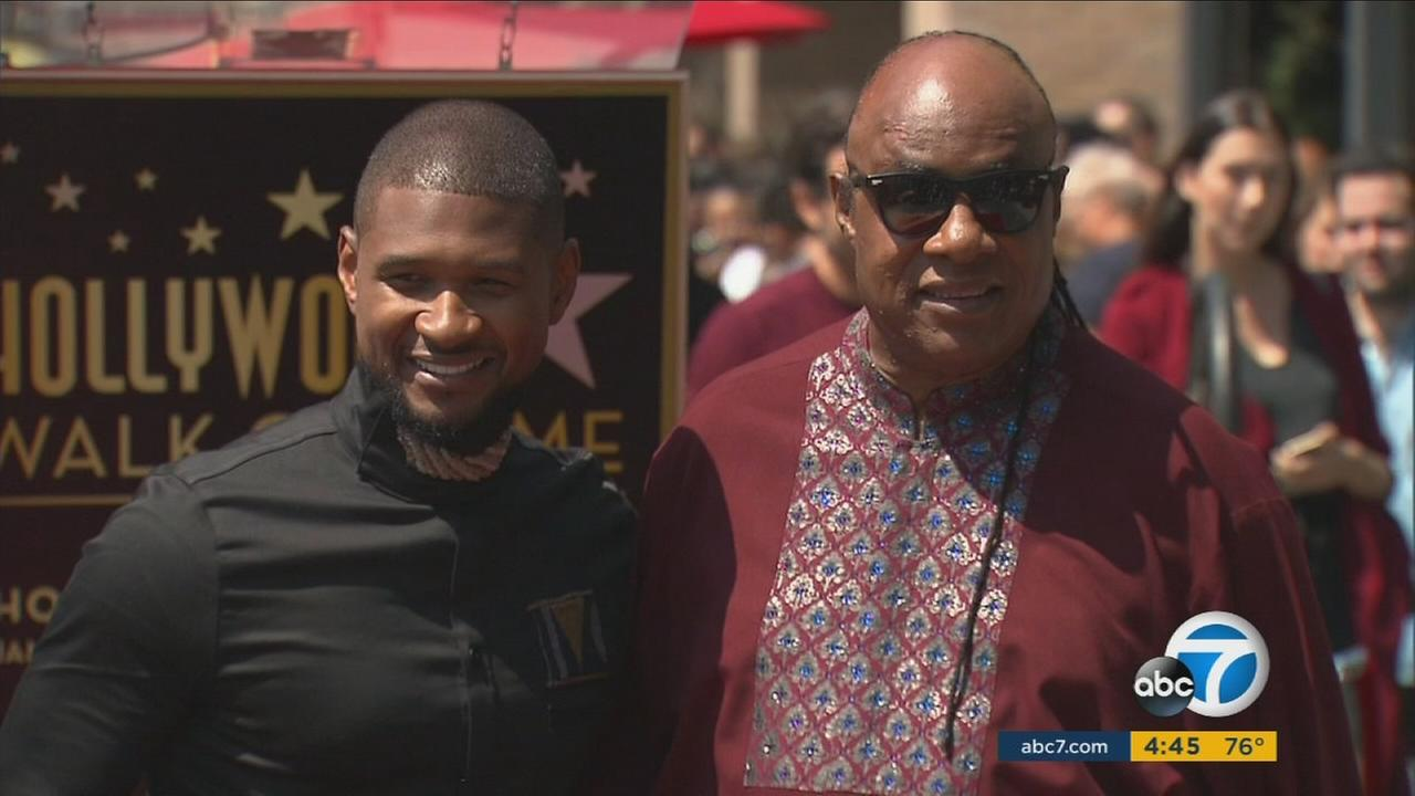 Singer Usher (left) was joined by Stevie Wonder as he received a star on the Hollywood Walk of Fame.