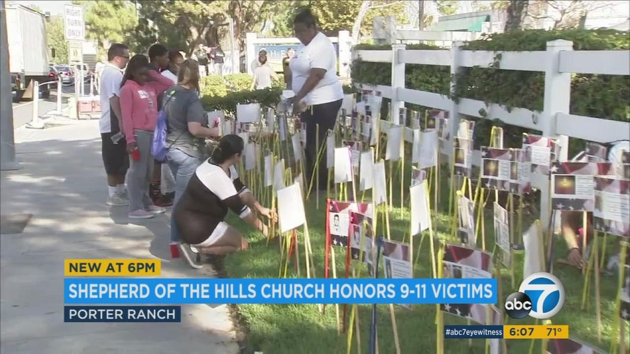 Shepard of the Hills Church in Porter Ranch is remembering the victims of 9/11 by placing flags along a memorial walkway.