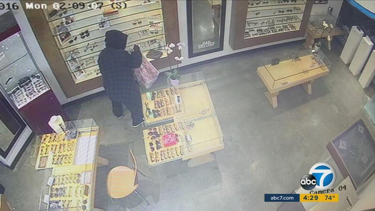 A burglary suspect is seen in an image from a surveillance video recorded at a business in Studio City.