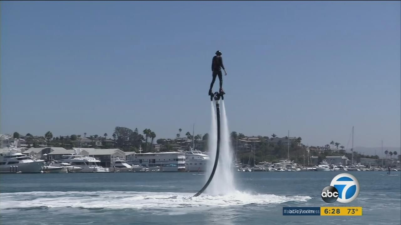 A teen with cancer came to Newport Beach to ride a water jetpack for the first time as he travels around the country crossing off his bucket list.