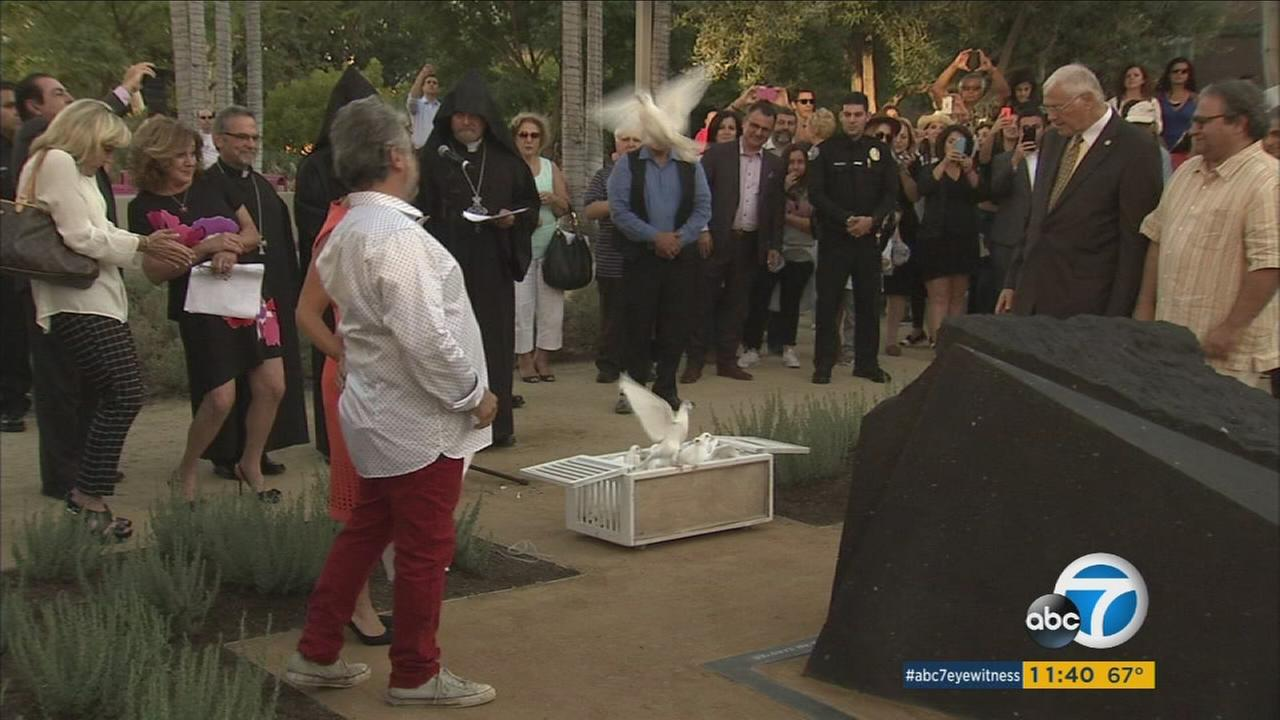 Relatives of survivors of the Armenian Genocide surround a new monument installed in downtown Los Angeles.