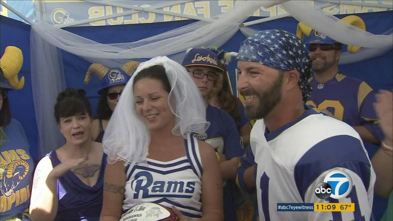 L.A. Rams fans marry during a wedding tailgate party on Sunday, Sept. 18, 2016.