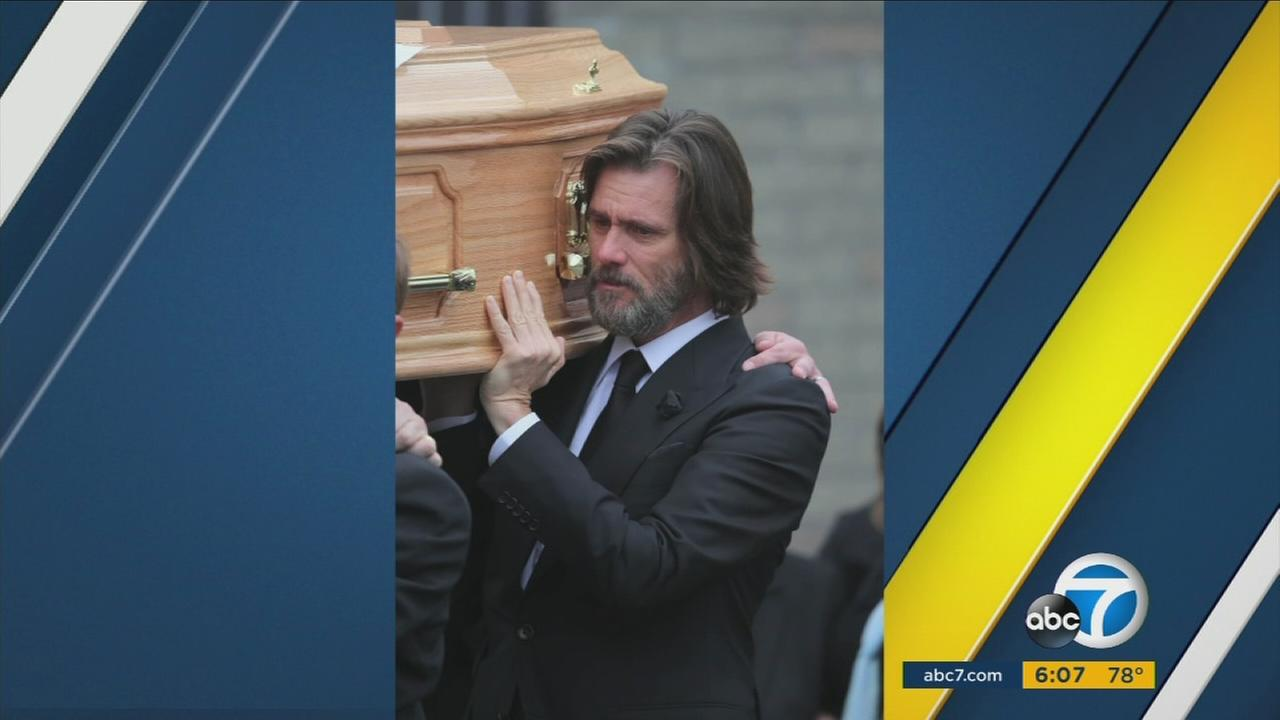 Jim Carrey is shown holding the coffin of his ex-girlfriend Cathriona White during her funeral in 2015.
