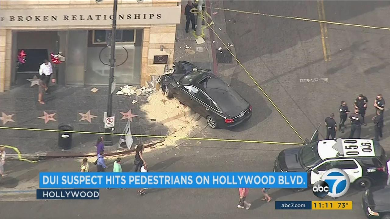 An Audi sedan struck two pedestrians in Hollywood and then smashed into the Museum of Broken Relationships building, officials said.