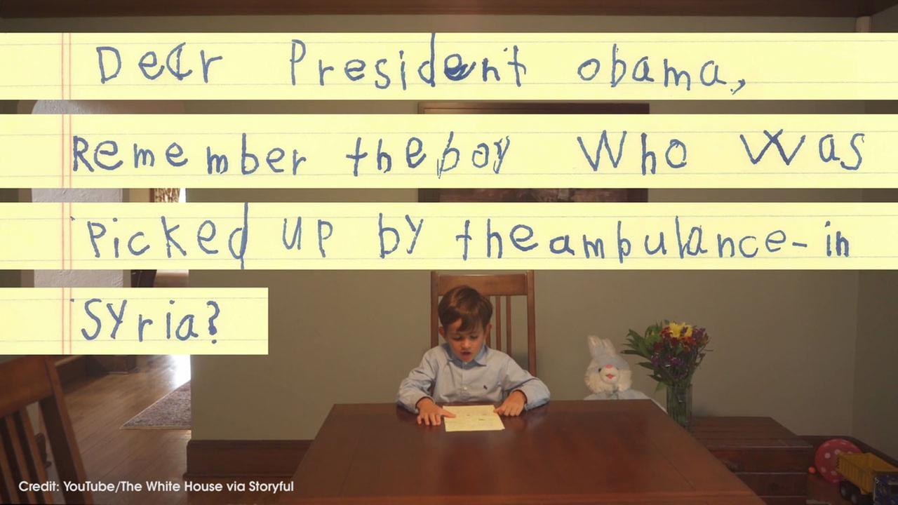 An image from a video posted by President Obama shows a New York boy named Alex reading a letter he wrote about wanting to take in a young Syrian refugee as part of his family.
