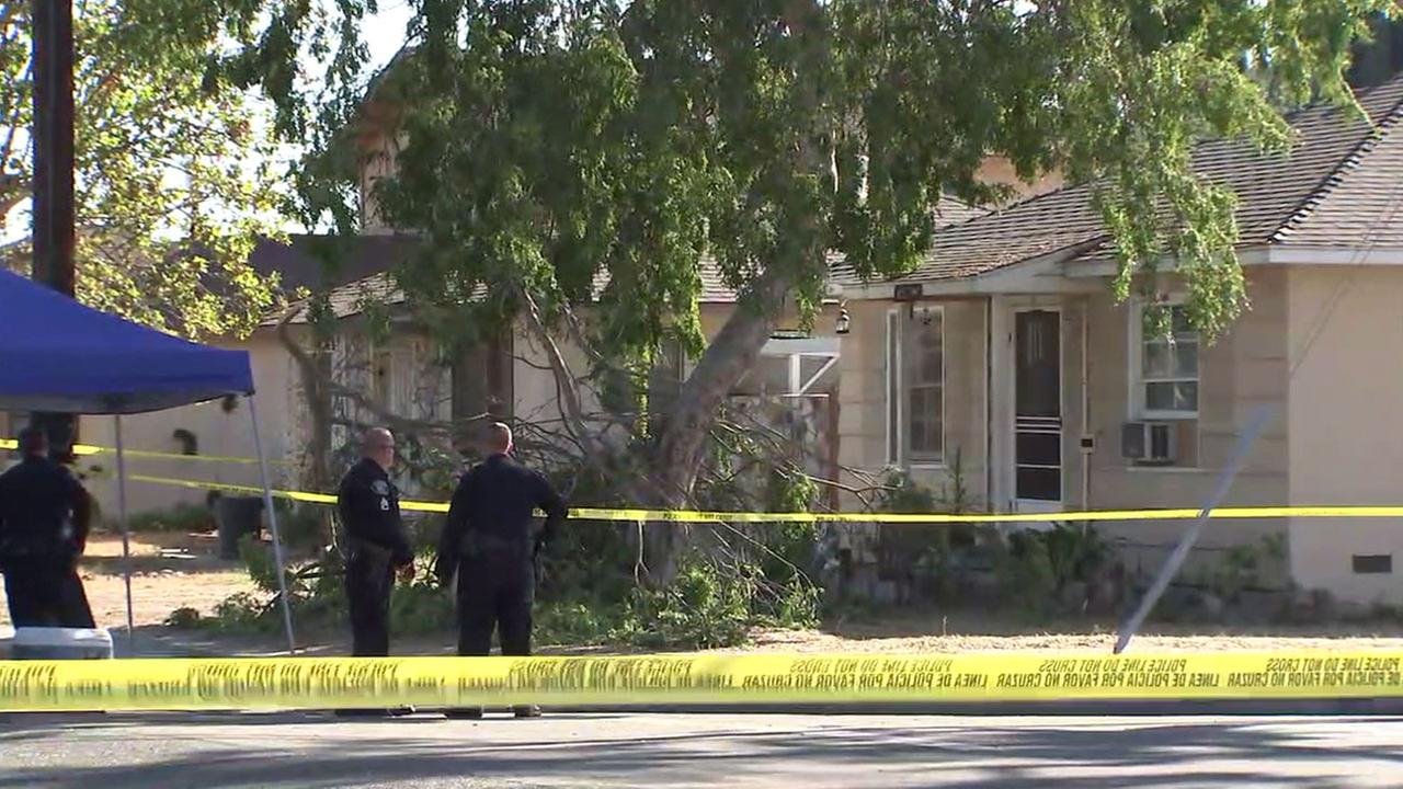 Authorities investigate the scene of a triple homicide at a home in Fullerton on Saturday, Sept. 24, 2016.