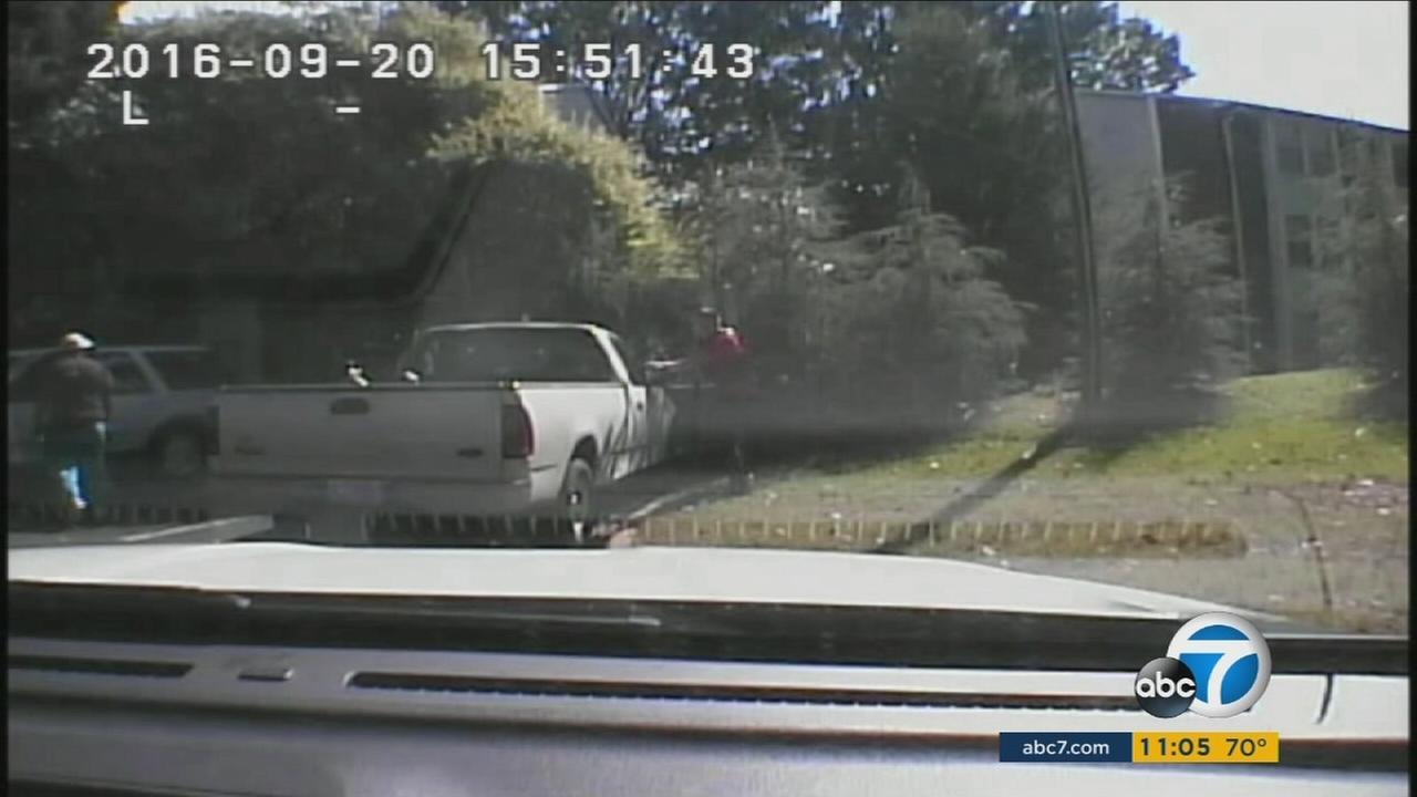 Dashboard camera footage shows the moments before an officer fatally shot Keith Lamont Scott in Charlotte, North Carolina.