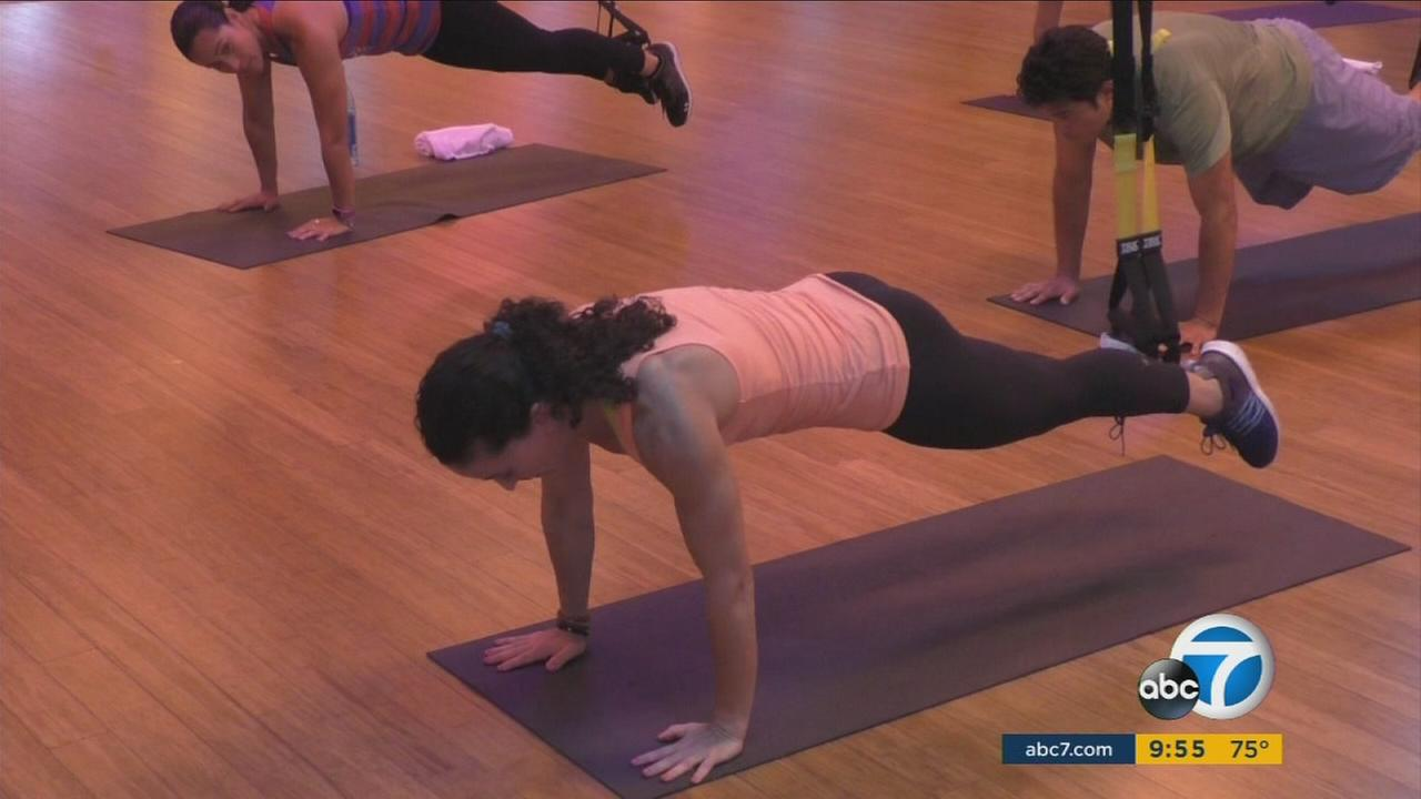 A new fitness trend is adding strength and intensity to traditional Zumba and yoga workouts.