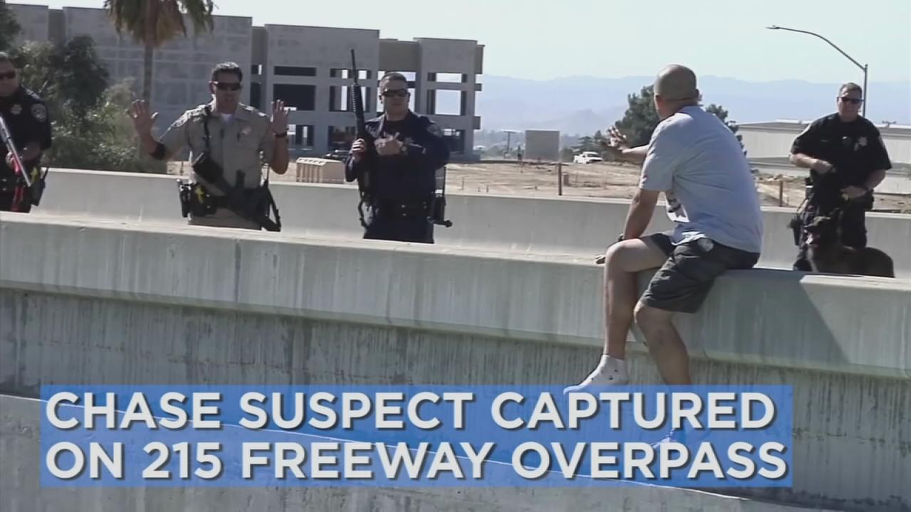 Officers with the California Highway Patrol caught a chase suspect on a 215 Freeway overpass before the man could jump on Monday, Sept. 26, 2016.