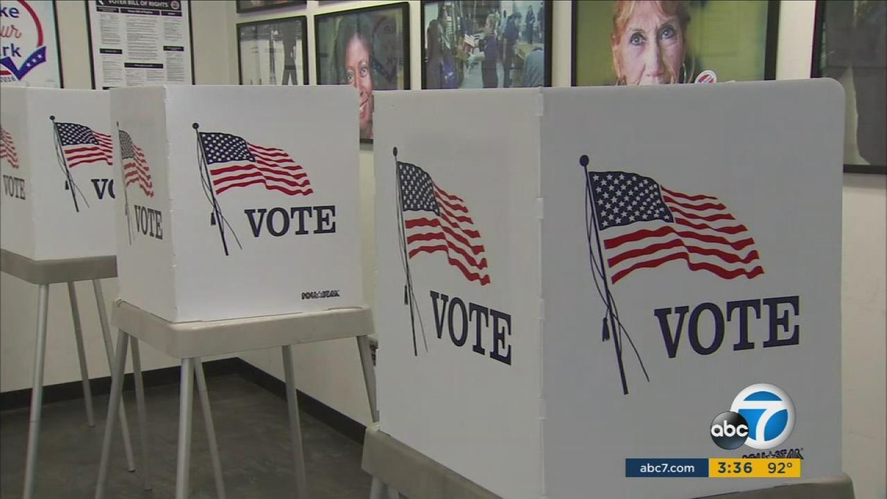 Voter registration booths are shown inside the Los Angeles County Registrars Office.