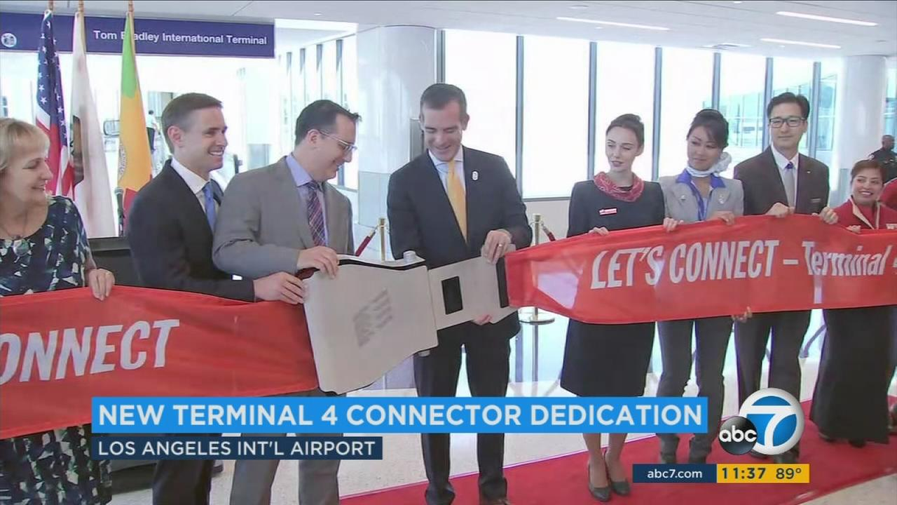 Mayor Eric Garcetti and other officials open the Terminal 4 Connector at the Los Angeles International Airport on Thursday, Sept. 29, 2016.