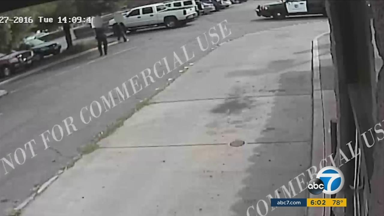 Surveillance video from a business shows the moments an El Cajon officer fatally shot Alfred Olango.