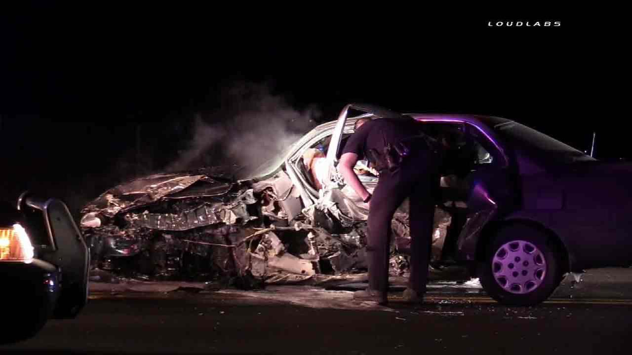 A violent crash in Hemet overnight caused a car to catch fire before a news photographer rushed to help, and it was all caught on camera.