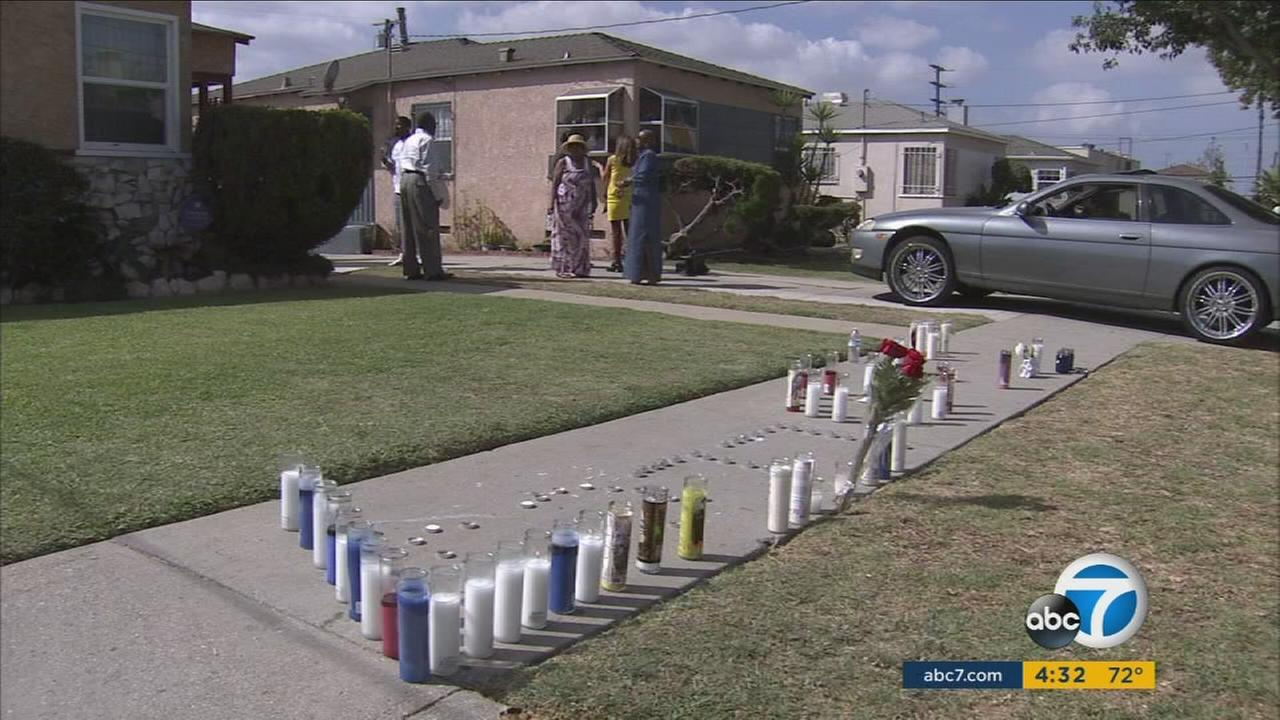 Candles decorate the front of a home where a teenager was killed in a police shooting in South Los Angeles following a car chase.
