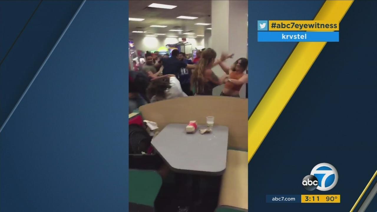 Cellphone video shows a massive fight inside a Miami, Florida Chuck E. Cheese.