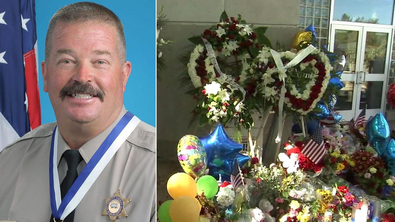 Sgt. Steve Owen, 53, is shown alongside a memorial constructed at the Lancaster Station.KABC