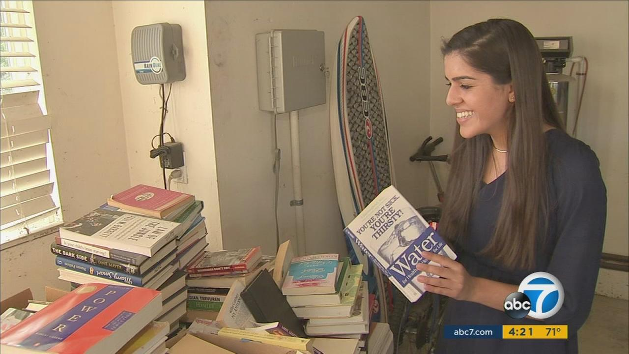 Sonal Kapoor, 17, shows off her collection of donated books that she gives to local non-profits and uses to raise money for a hospital in South America.