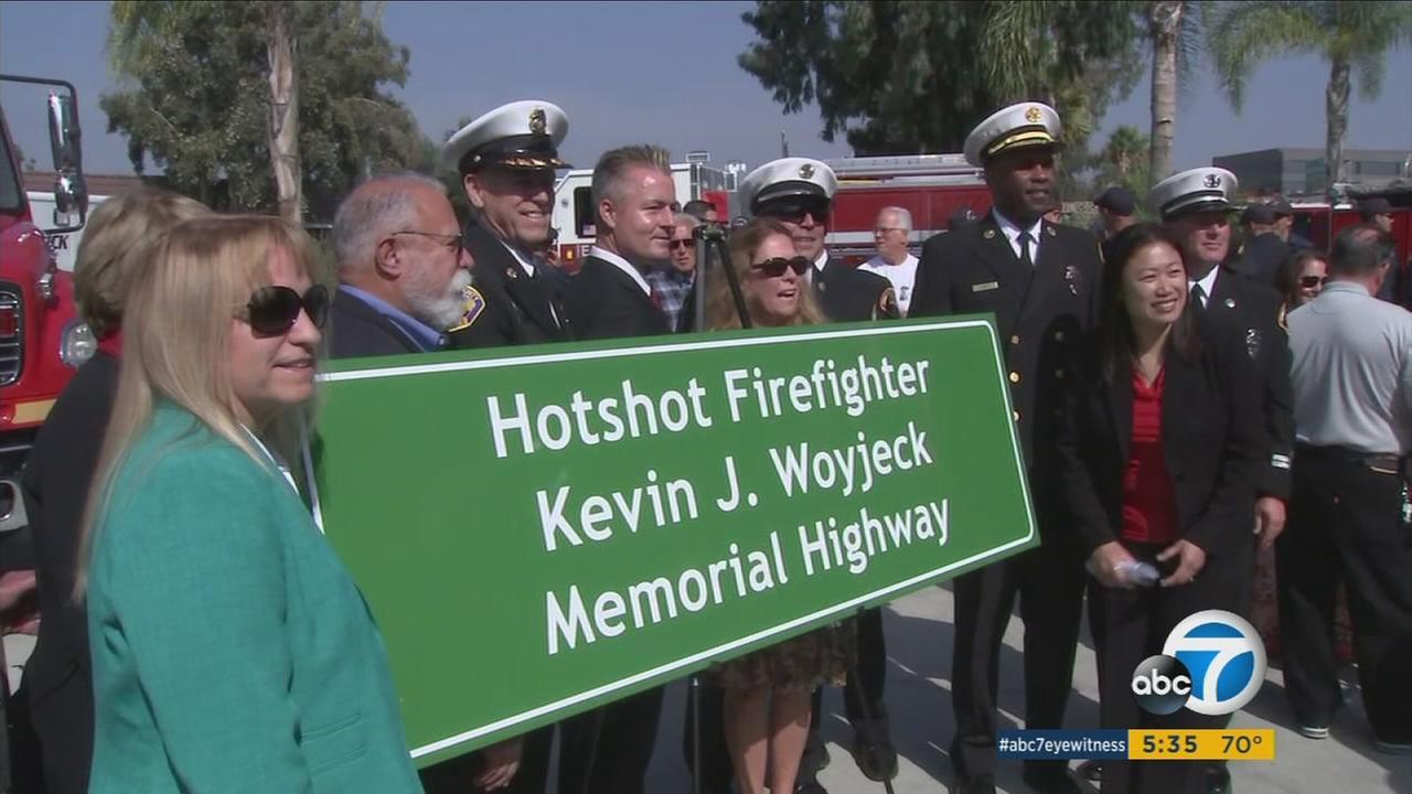 A 405 Freeway sign dedicated to firefighter Kevin Woyjeck, who was killed in a massive Arizona wildfire in 2013.