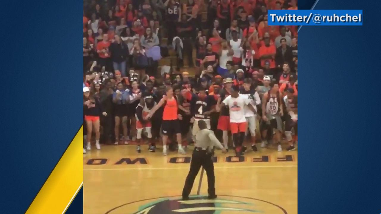 Lt. Deuntay Diggs dances at a pep rally at North Stafford High School in Virgina.