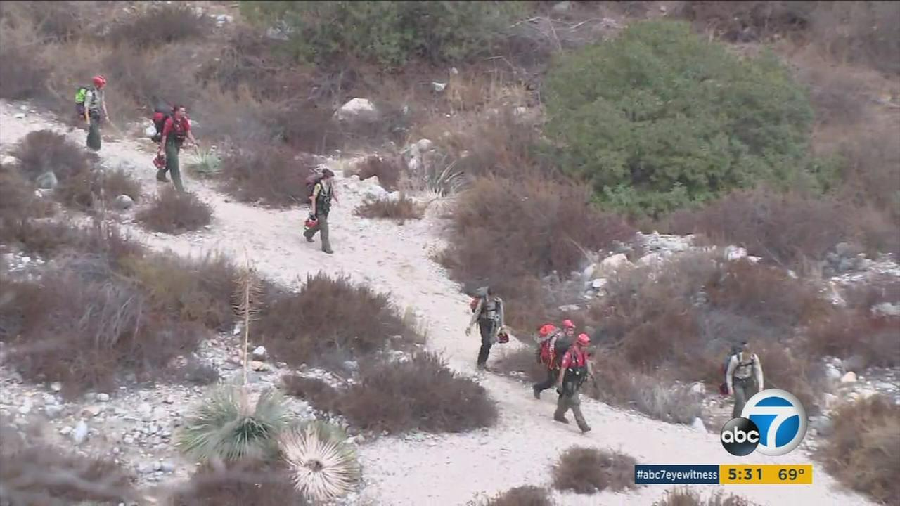 Two hikers were successfully rescued from 1,000 feet above Eaton Canyon Monday morning after foggy weather hampered rescued efforts overnight.