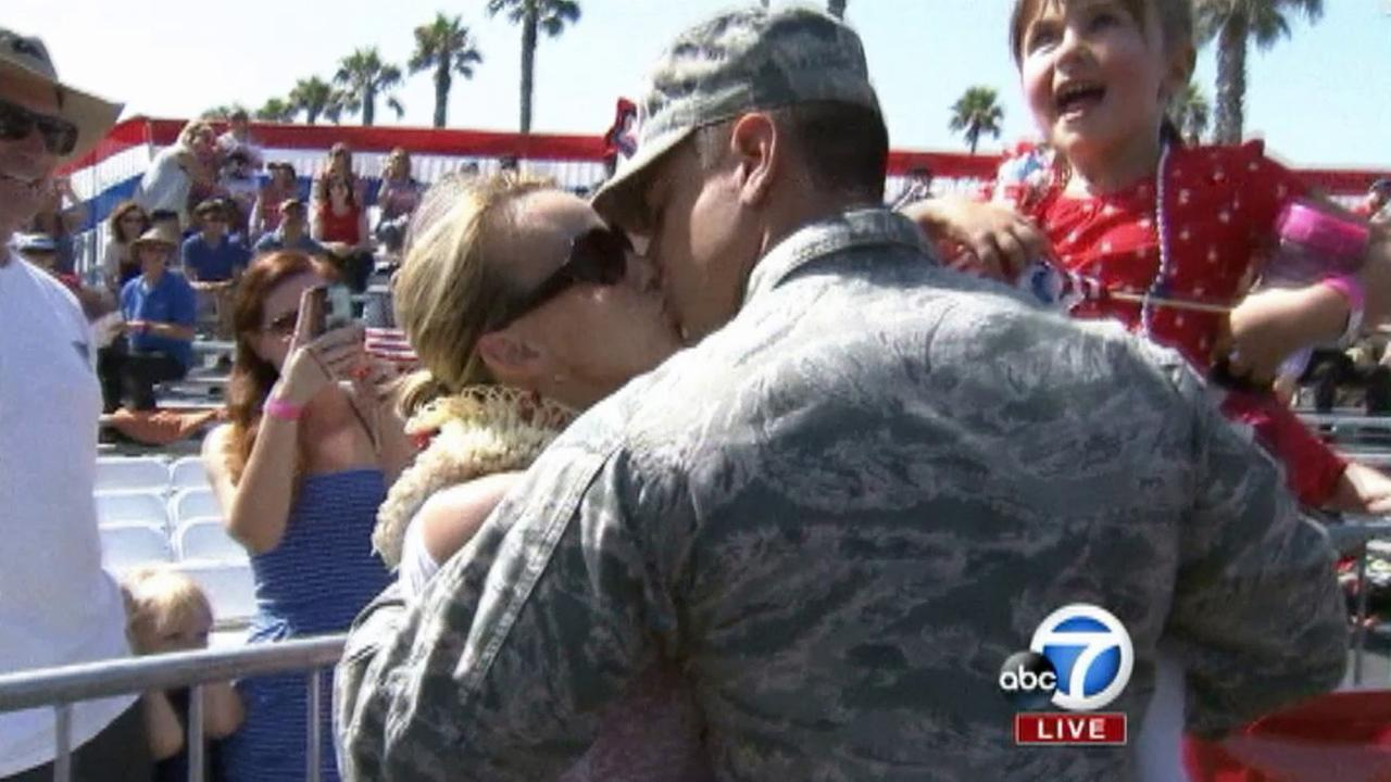 First Lt. Sean C. Bruderer of the U.S. Air Force kisses his wife at the 4th of July Parade in Huntington Beach on Friday, July 4, 2014.