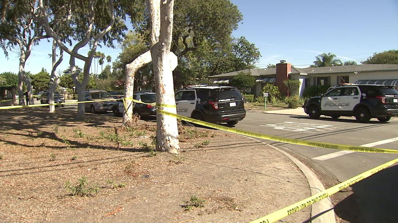 Authorities cordoned off a portion of a neighborhood in Garden Grove after a man was found dead and a child died at the hospital on Saturday, Oct. 22, 2016.