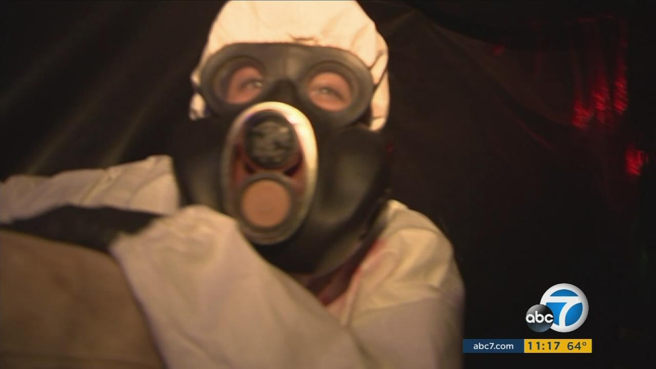 A scare actor is shown inside a haunted house maze created by a 16-year-old boy in Los Feliz.