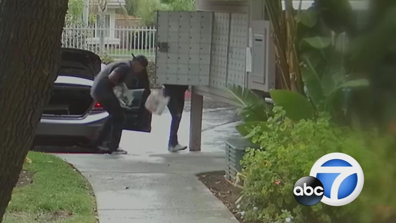 Two mail theft suspects were caught on camera nearly running over a woman who confronted them in Moreno Valley on Sunday.