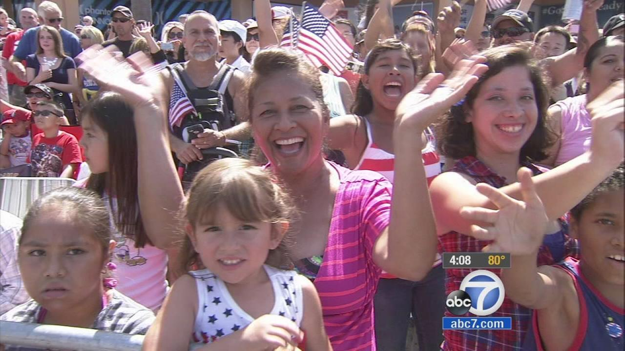 Crowds cheer at Huntington Beachs annual Fourth of July parade on Friday, July 4, 2014.