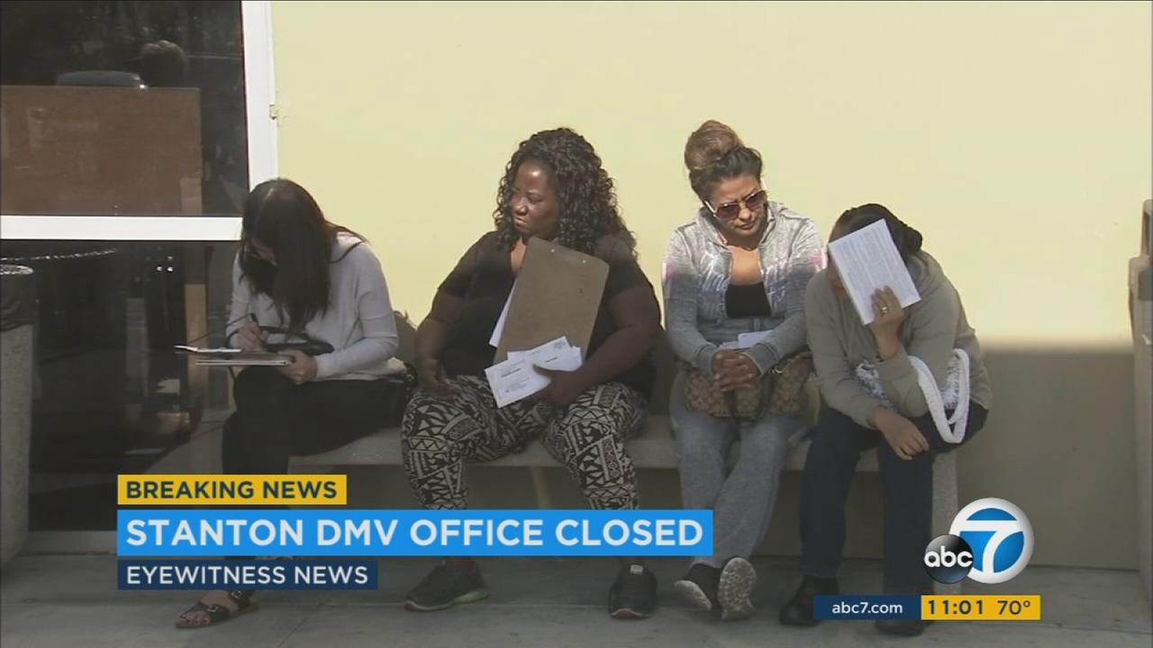 Customers stand inside the Stanton DMV office during a computer outage that has affected officers all over the state on Tuesday, Oct. 25, 2016.