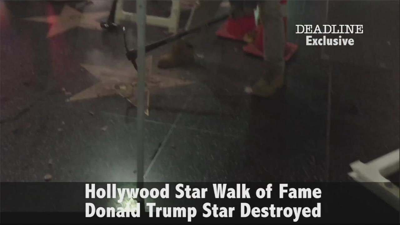 Still image from Deadline.coms exclusive video shows a vandal smashing Donald Trumps star on the Hollywood Walk of Fame.