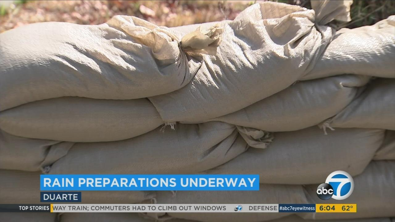 Sand bags are seen piled along Duarte roadways ahead of rain expected to hit the Southland Thursday night and Friday morning.