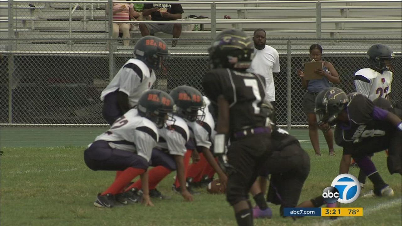South Los Angeles kids are shown playing on the Watts Bears team.