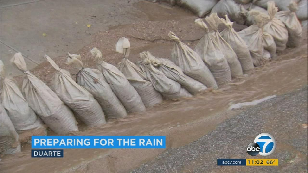 Residents living near areas impacted by wildfires are getting prepared ahead of a storm that is expected to bring rain and possible debris flows Thursday night and Friday morning.