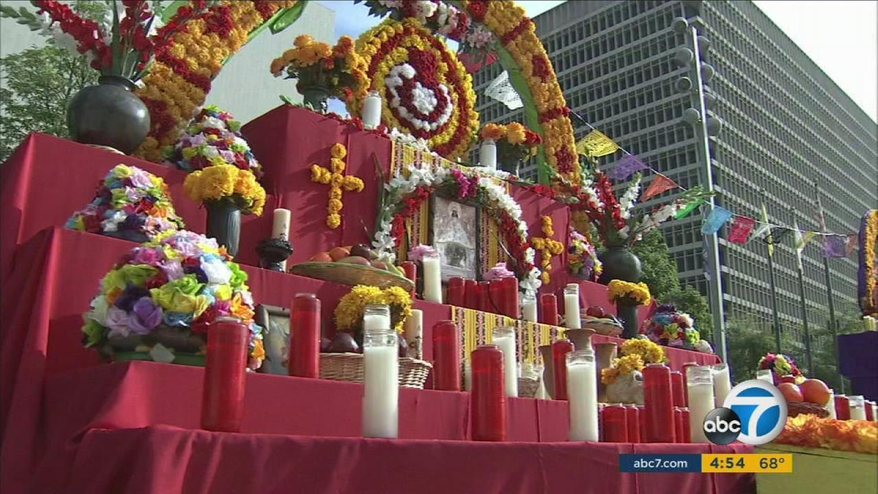 A series of altars set up in downtown LAs Grand Park honor deceased loved ones for the Mexican tradition of Dia de los Muertos.