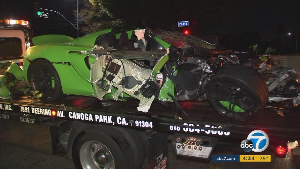 Detectives are continuing to investigate a crash involving a McLaren and possibly two other vehicles in Woodland Hills that sent two people to the hospital and mangled the high-end sports car.