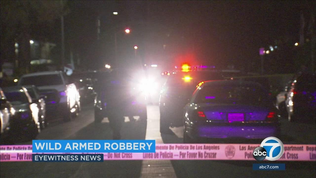 Authorities searched for a suspect wanted in an armed robbery in Tarzan on Wednesday.