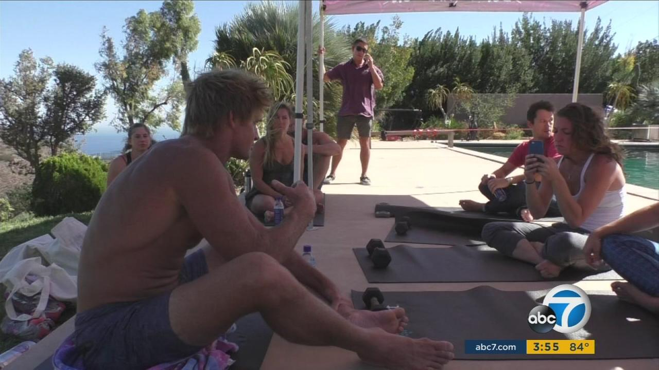 Couple shows other people how to stay youthful with fitness program they designed.