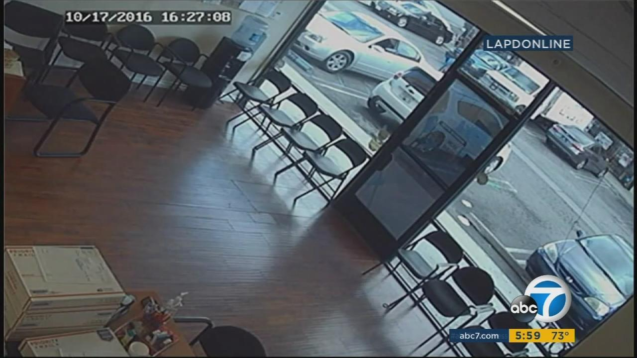 Surveillance video shows an elderly woman being run over by a car in reverse in a Van Nuys shopping center on Monday, Oct. 17, 2016.