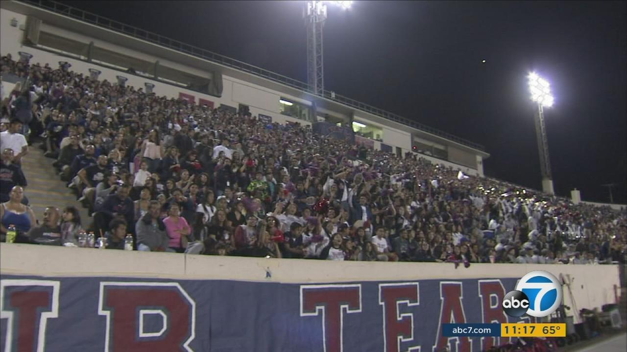 Thousands of fans fill the stadium for a Roosevelt and Garfield high school football game, one of the longest high school rivalries on the west.