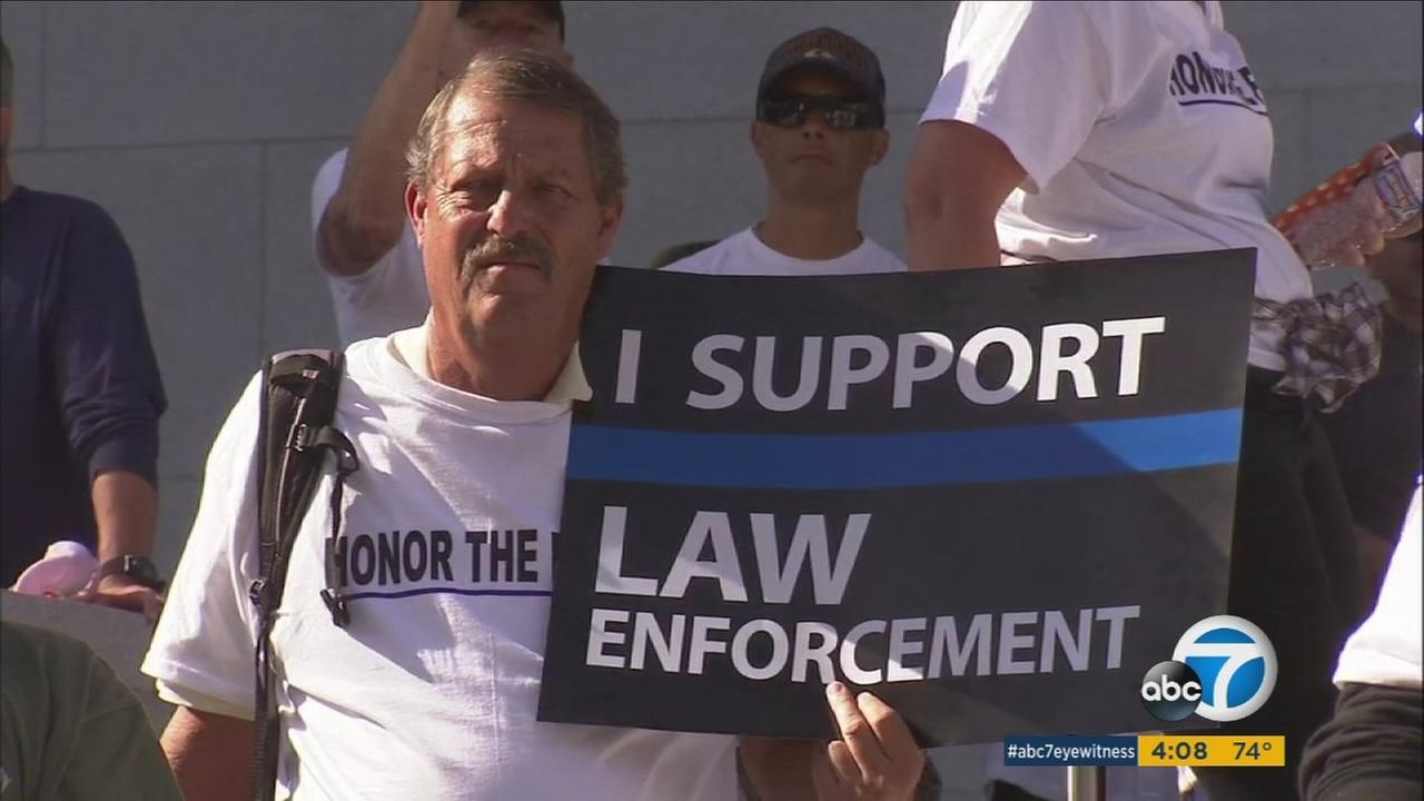 A man shows his support for law enforcement during a rally against propositions 57 and 62 in downtown Los Angeles on Saturday, Nov. 5, 2016.