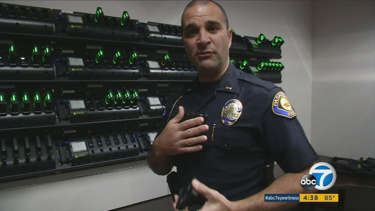 A Pasadena lieutenant shows off one of the new body cameras.