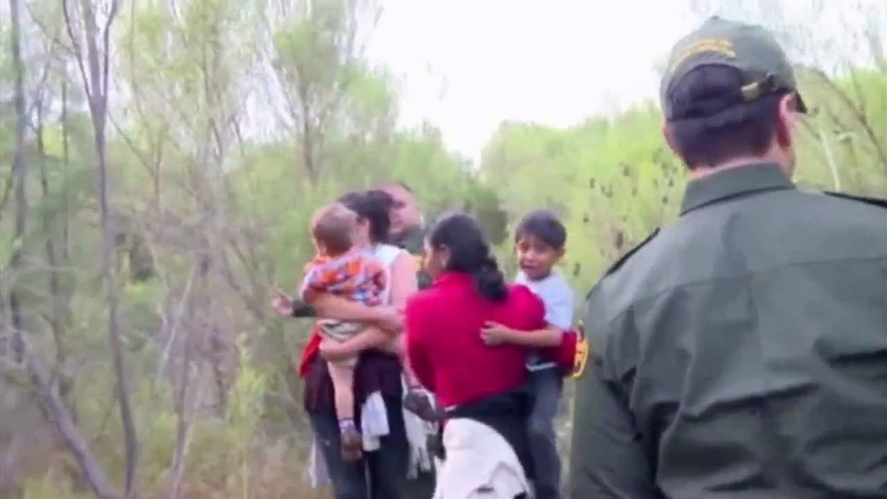 Women carrying children are seen in this undated file photo.